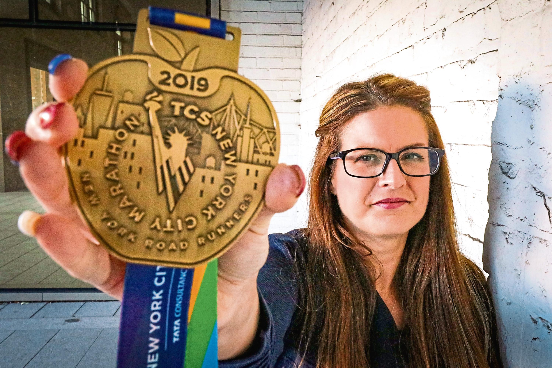 Lisa with her New York Marathon medal.