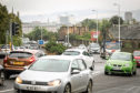 Traffic on Lochee Road in Dundee.