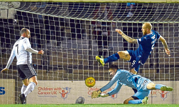 Conor Hazard makes a save during a tie against Ayr in October.