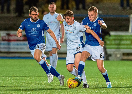 Queen of the South's Michael Paton and Daniel Pybus in action with Dundee's Finlay Robertson.