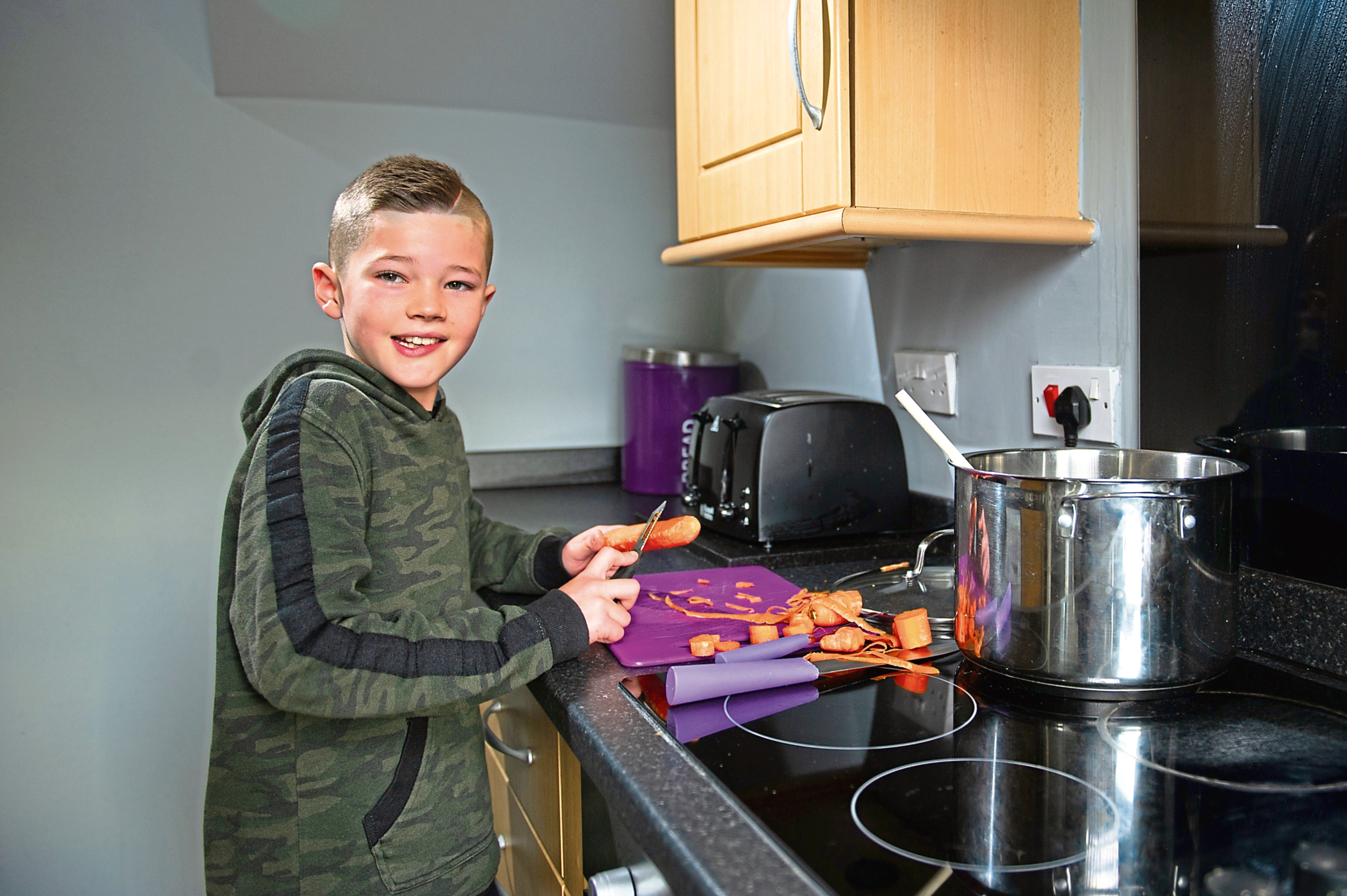 Telegraph  News – Dundee – Matteo Bell story - CR0016459 - Mum and son who made soup and handed it out to homeless people in the city centre. Picture Shows; Ollie Downie at home working on another pot of soup, Liff Crescent, Dundee, 15th November 2019 – Kim Cessford / DCT Media