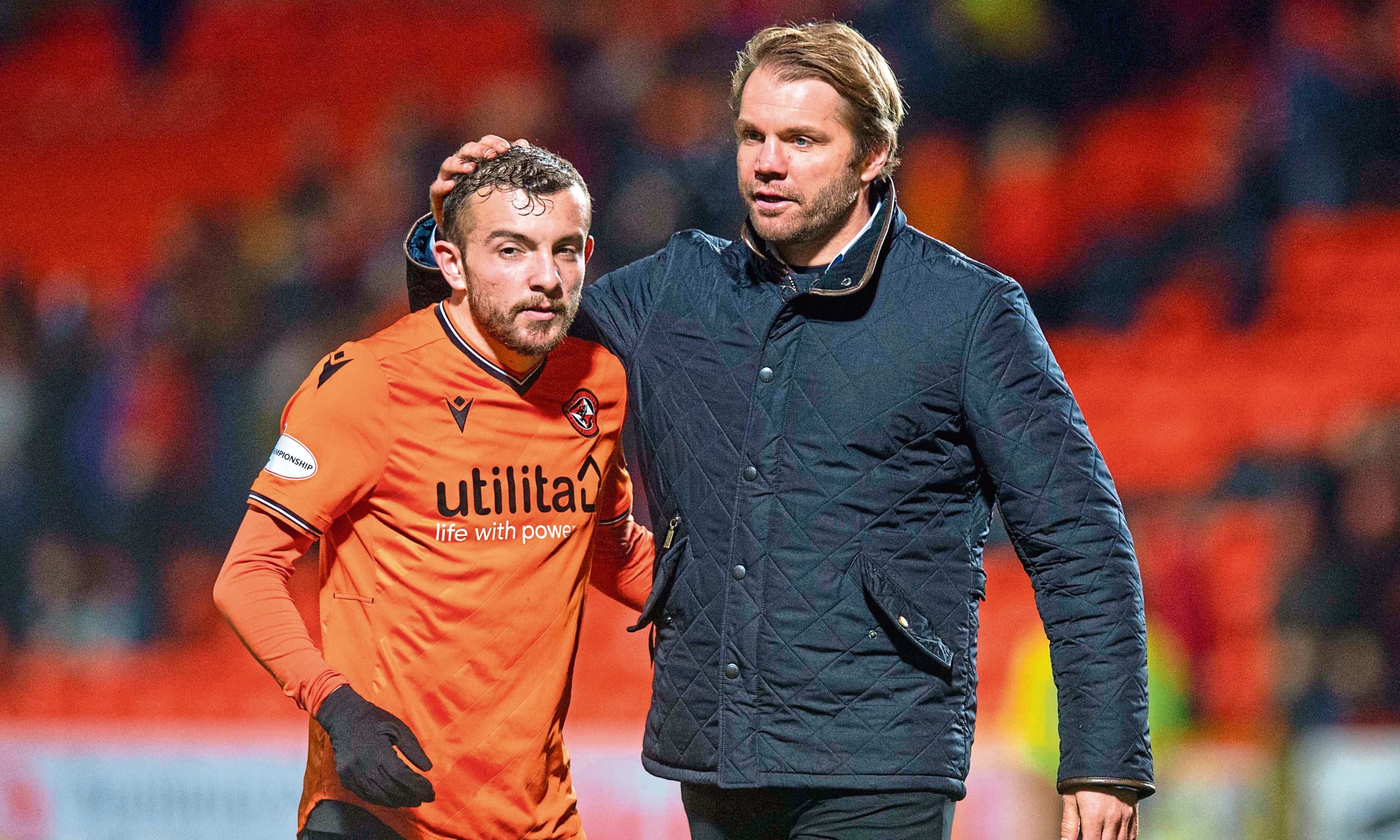 United Manager Robbie Neilson celebrates at full time with Paul McMullan after defeating Queen of the South.