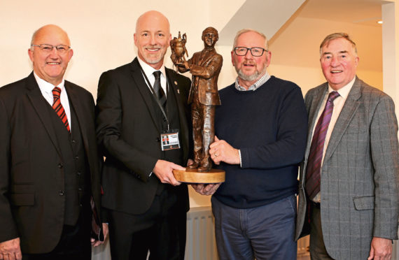 Dundee United Community Trust chairman David Dorward, club owner Mark Ogren, sculptor Alan Heriott and Jim McLean Statue Group chairman George Haggarty with a bronze model of how the finished statue will look.
