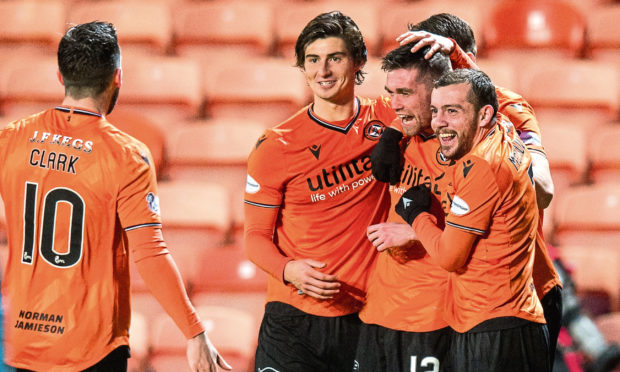 Sam Stanton celebrates his goal to make it 3-0 during the match between Dundee Utd and Queen of the South at Tannadice on Saturday.