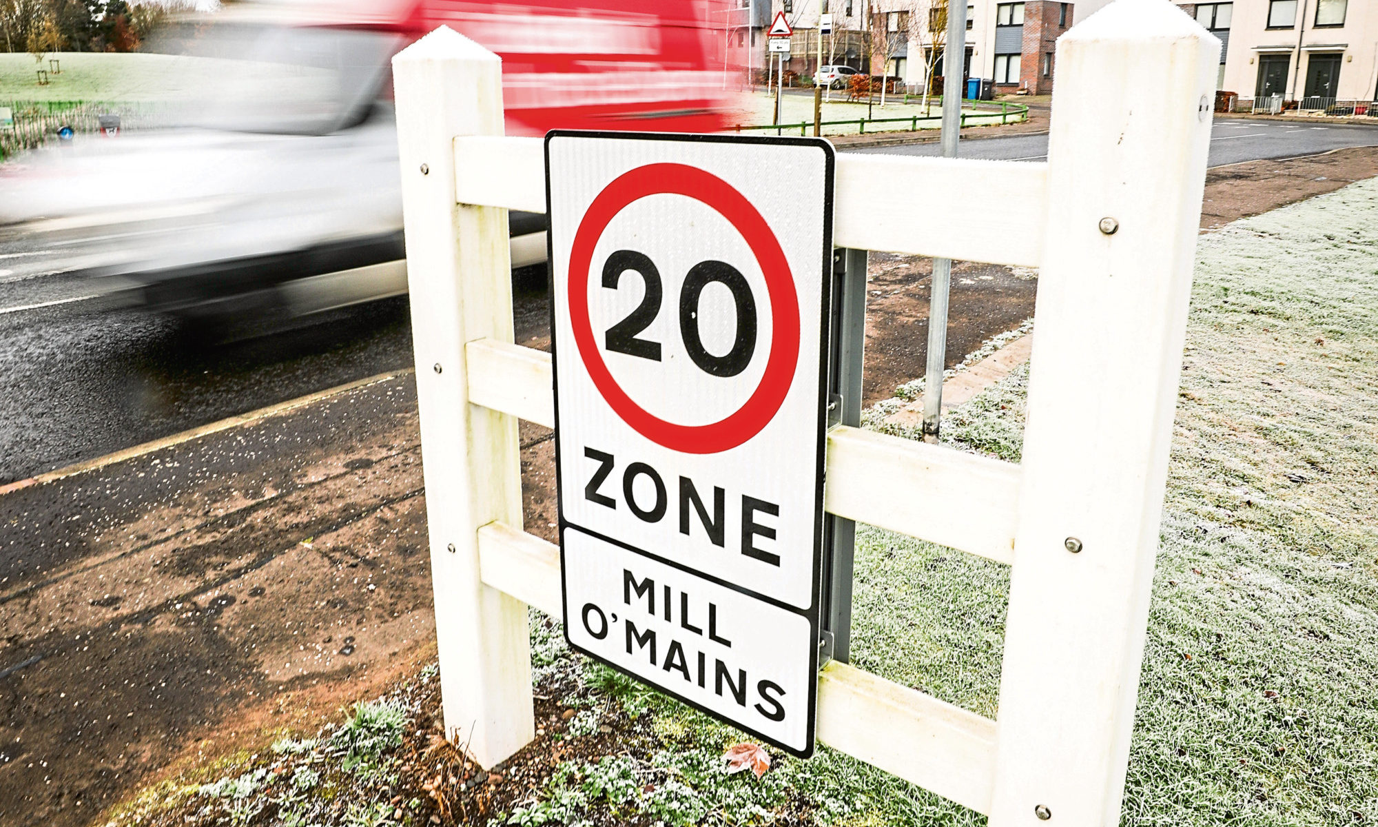 Tele News, Dundee story, CR0016561 . Antisocial behaviour and speeding in Mill o Mains, Dundee as people use the estate as a short cut to miss Forfar Road traffic lights. Pic shows; Mill o' Mains estate and cars speeding past 20mph signs. Tuesday, 19th November, 2019. Kris Miller/DCT Media.