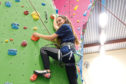 Sam, 15, shows her head for heights as she tackles the wall at Perth College where she does all her training.