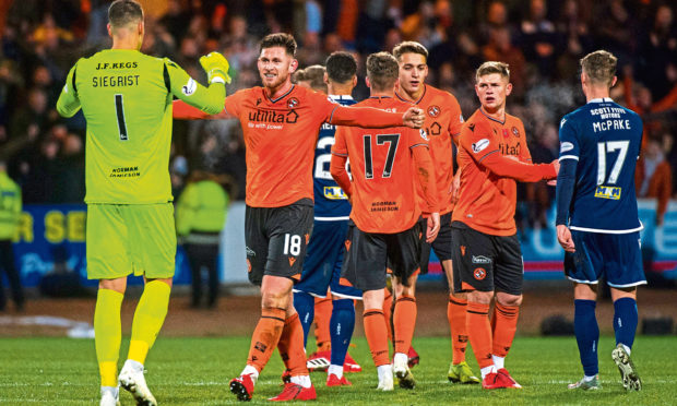 Calum Butcher celebrates at the end of the 2-0 win against Dundee at Dens.