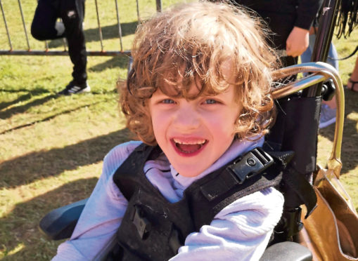 Kade Logan, who had his wheelchair stolen from his home in Invergowrie.