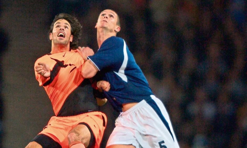 Lee Wilkie battles with Holland's Ruud van Nistelrooy