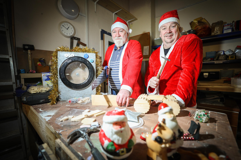 Thomas McKenna and George Ferguson ready to start work on the toys.