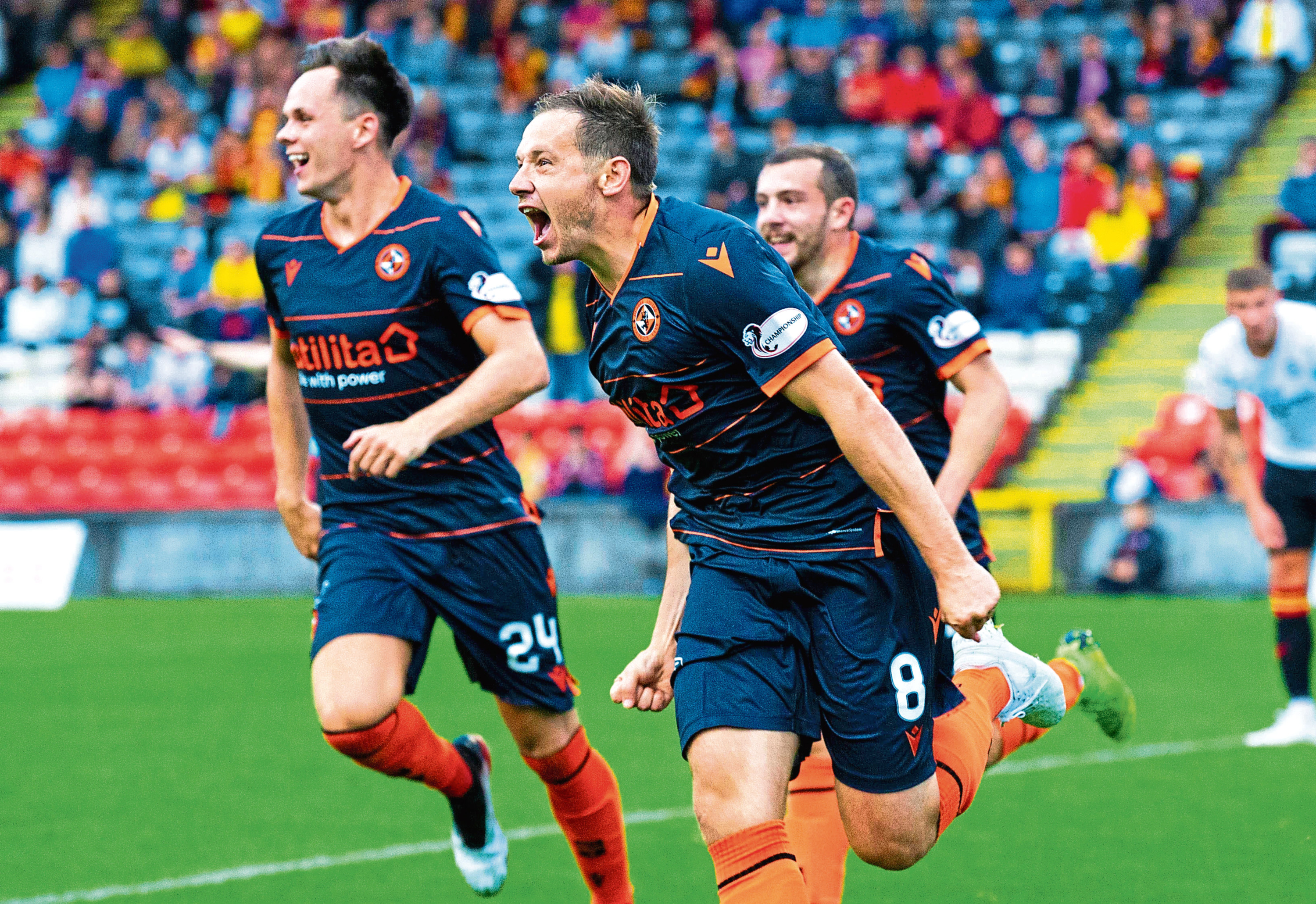Peter Pawlett wheels away in delight after making it 2-1 to Dundee United.