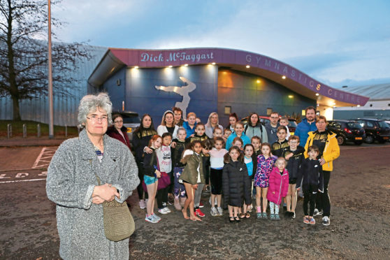 The gymnastics group are pictured outside the centre with chair of the club, Clare Huxley.