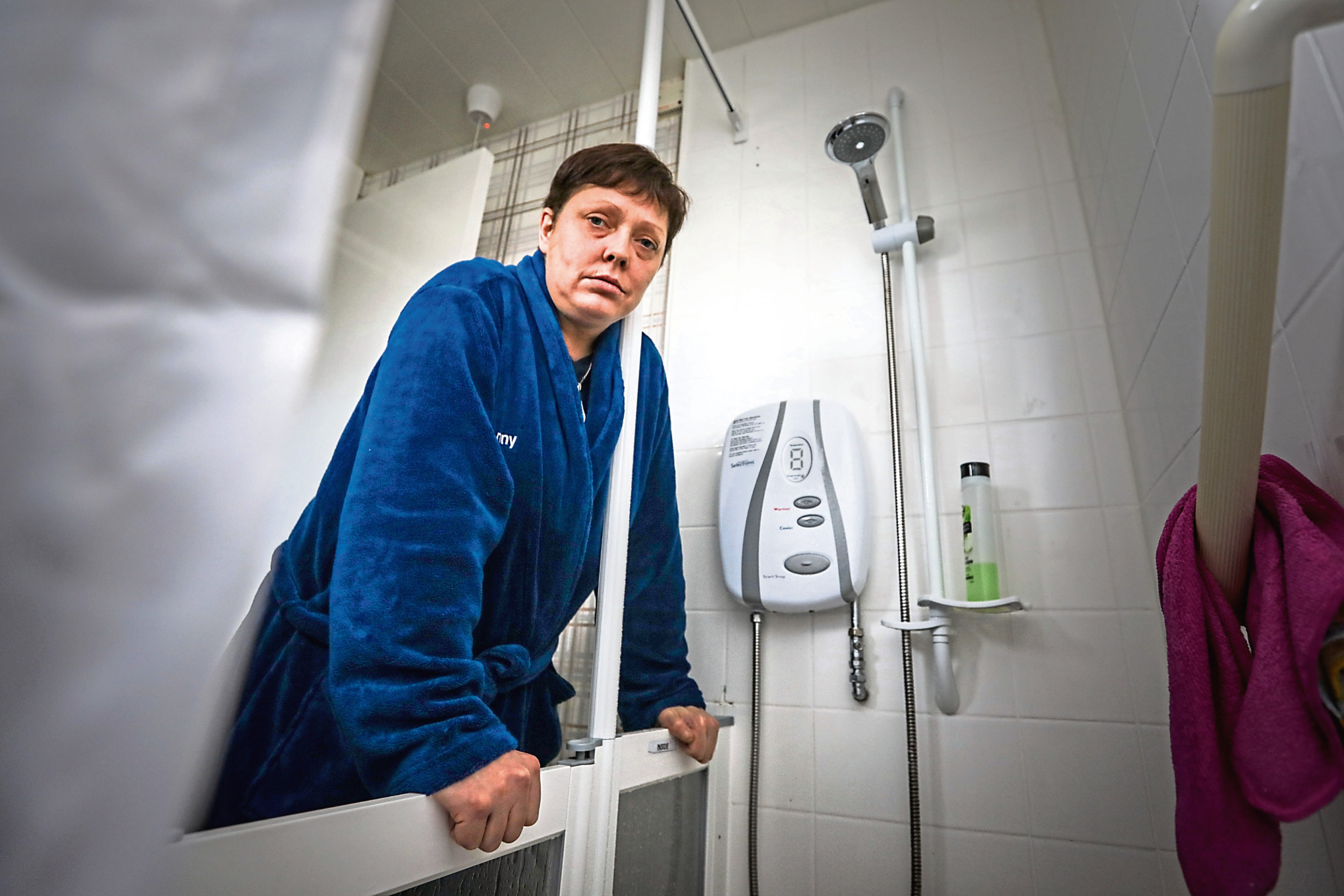 Kerry Bonella is having issues with her council-flat shower.