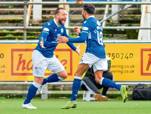 Queen of the South's Stephen Dobbie (left) celebrates his opening goal during the match between Queen of the South and Dundee United.