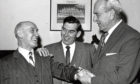 Bobby Calder, left, is presented with an inscribed gold watch by Mr C. B. Forbes, the club chairman. Mr Calder had 21 years of service as chief scout for Aberdeen. Dons manager Eddie Turnbull also pictured, centre.