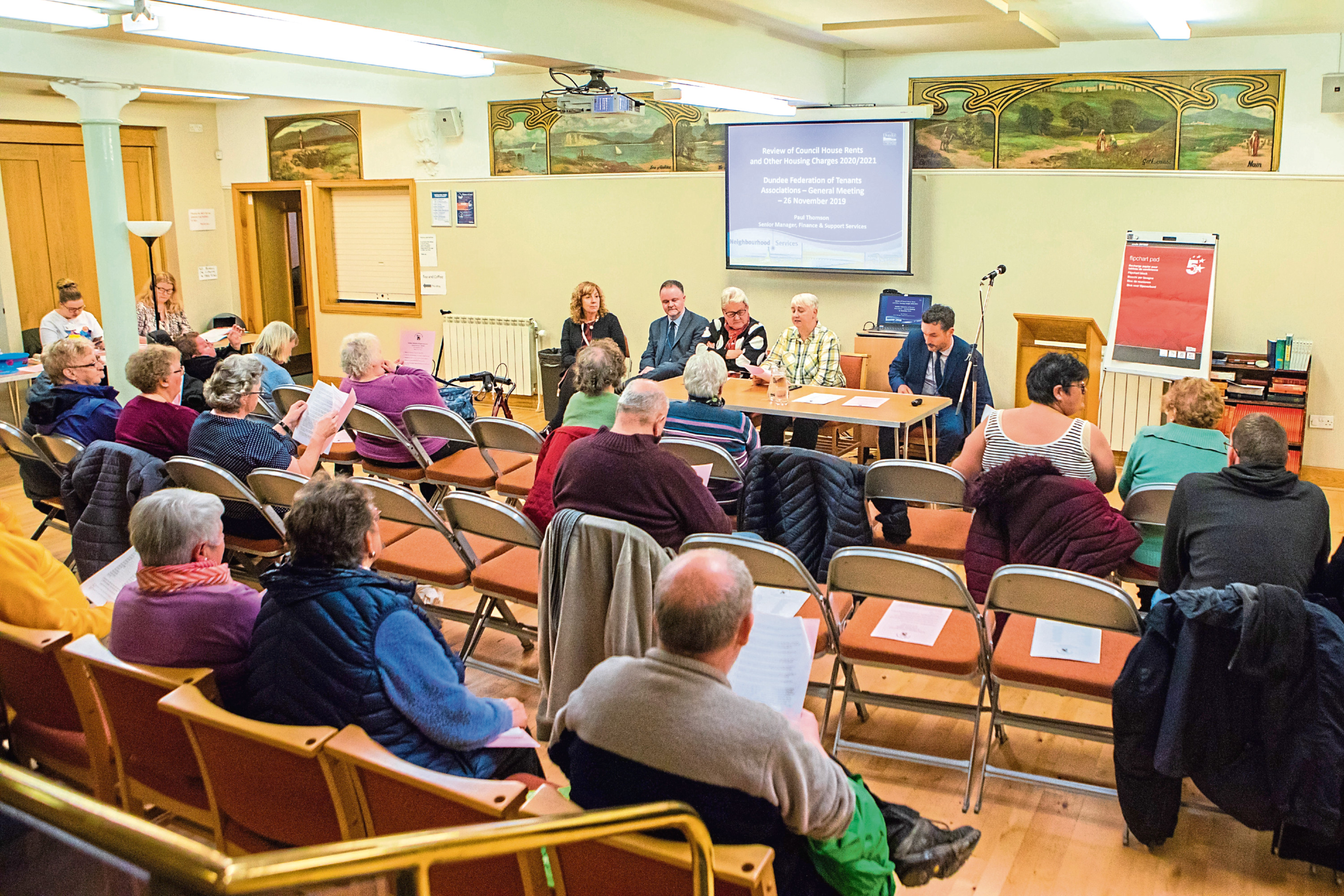 Council officials at a meeting with tenants.