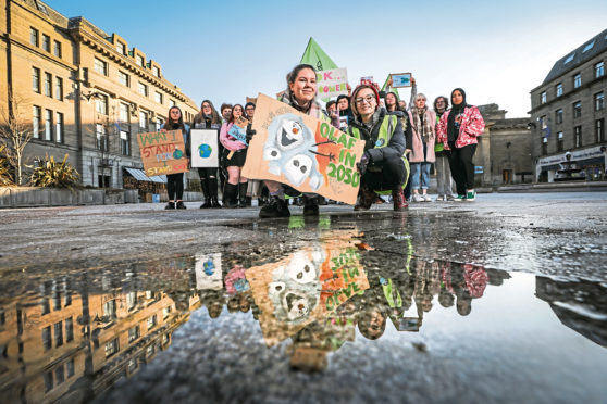 Local pupils Hannah Mackay and Elsie MacDonald taking part in Climate strike protests as part of Extinction Rebellion event in Dundee.