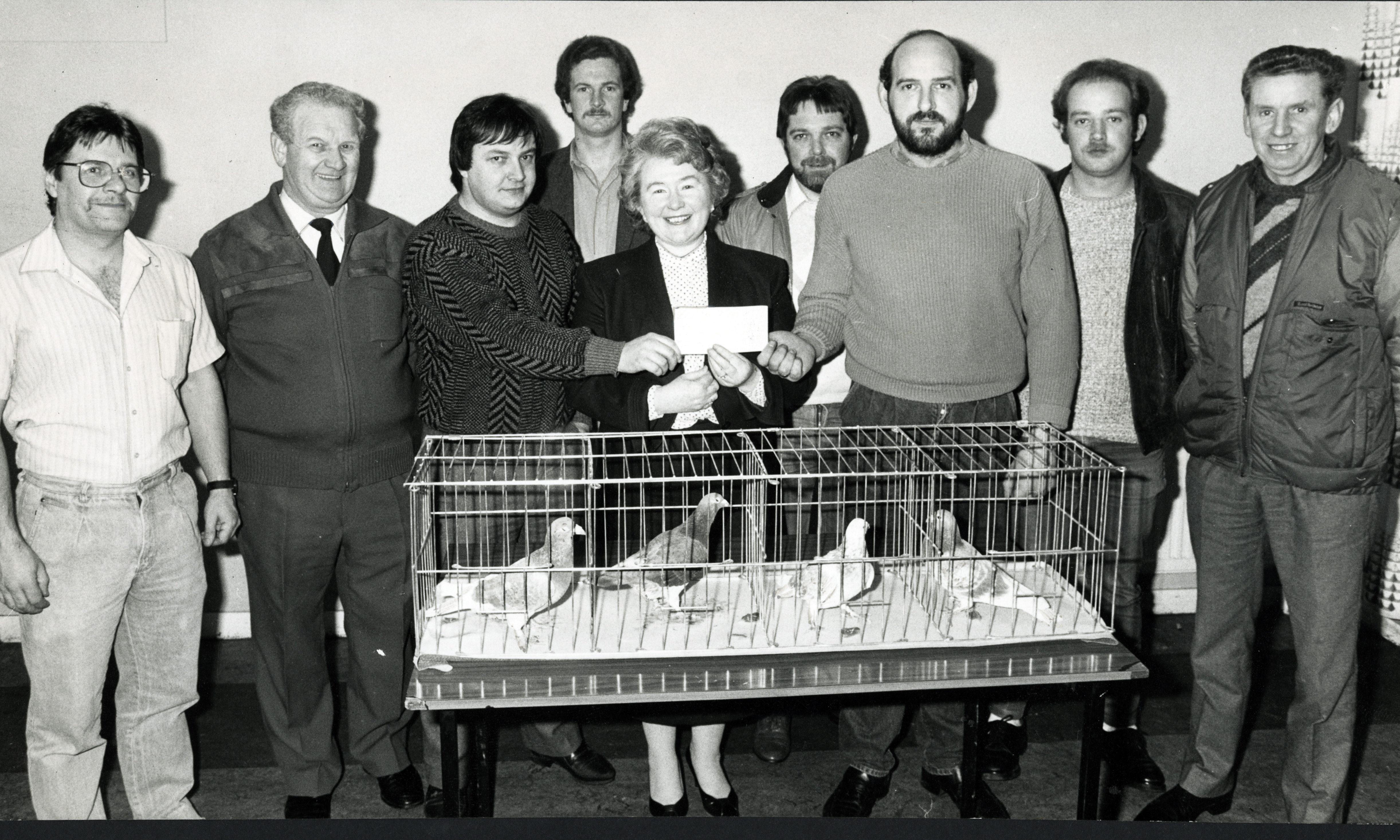 Ardler Racing Pigeon Club members donate to the appeal.