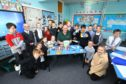 Kenneth Linton, of Dundee Foodbank, pictured with P5 pupils at Ardler Primary School.