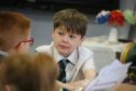 Pupils in class at St Clements Primary School last year, before the outbreak of Covid-19. (Library image).