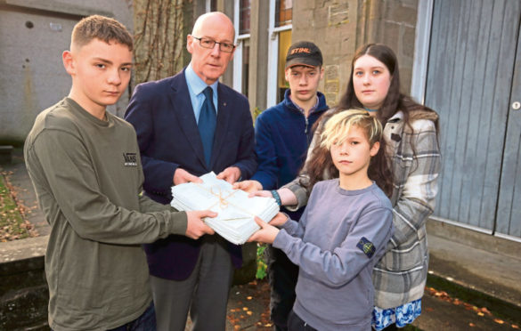 John Swinney recieved a petition from pupils Sol Archibald, Duncan Fairlie, Tori Rennie and Ben Gilyeat when the school closed.