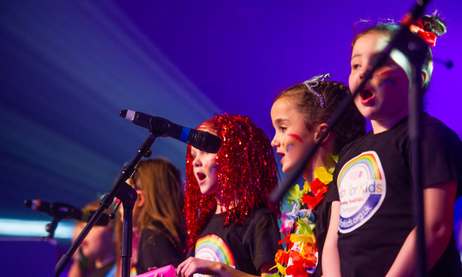The Help for Kids choir performs at the Strictly Come Prancing event.