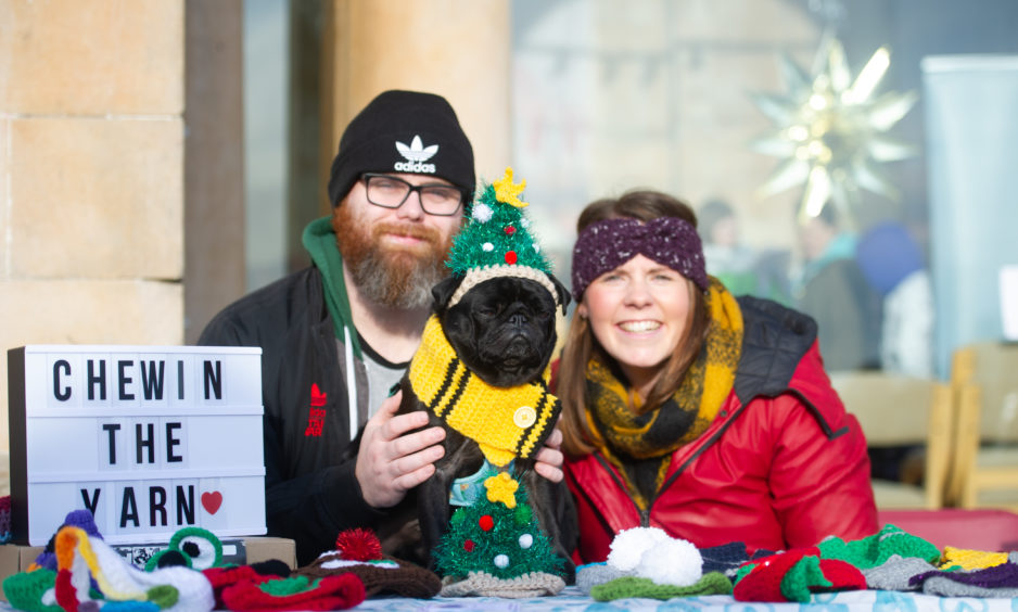 Chewin The Yarn stall. From left: Billy Stirling, Chewie and Nikki Stirling.