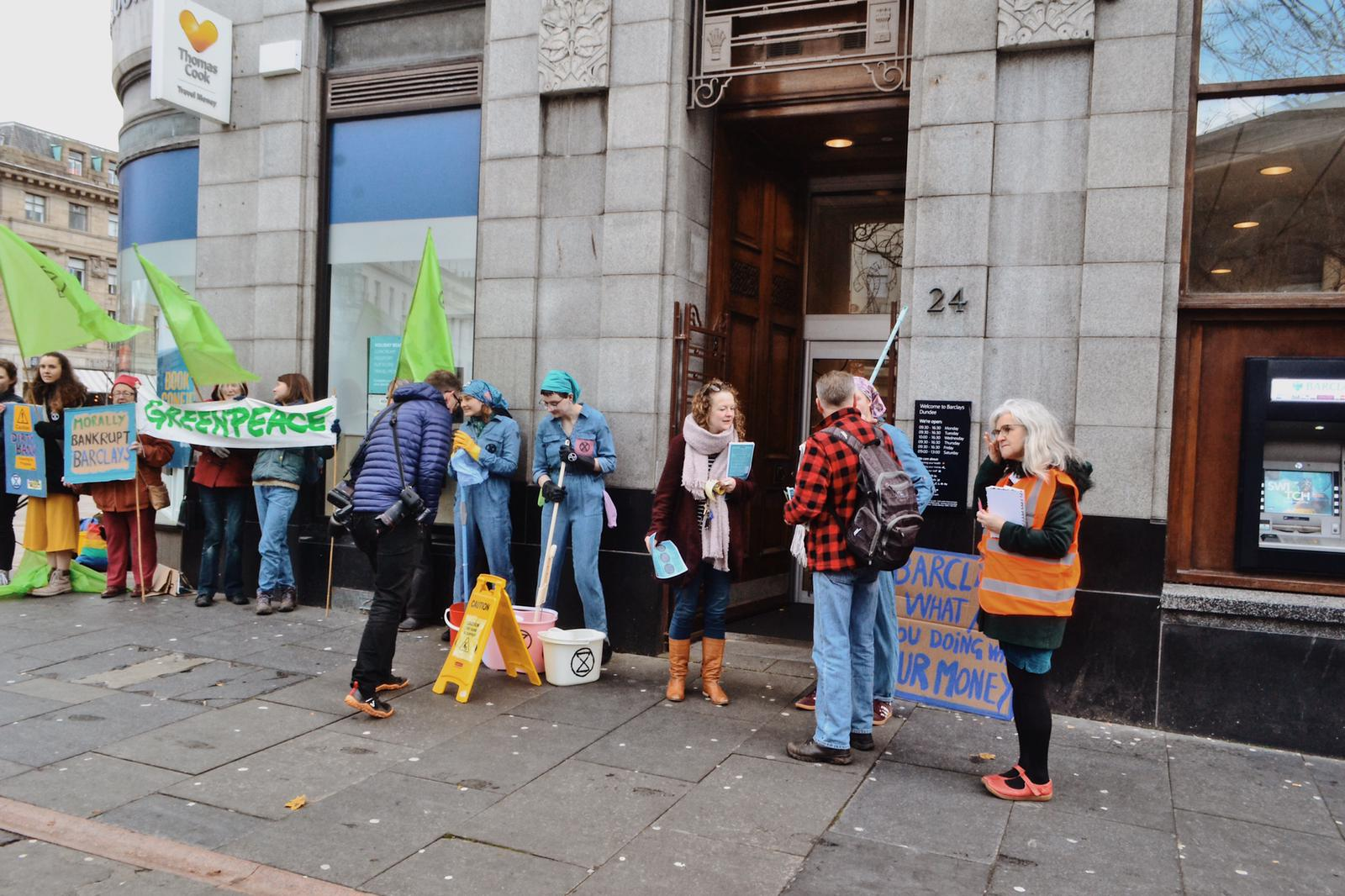 Environmental protesters outside Barclays in Dundee City Square.