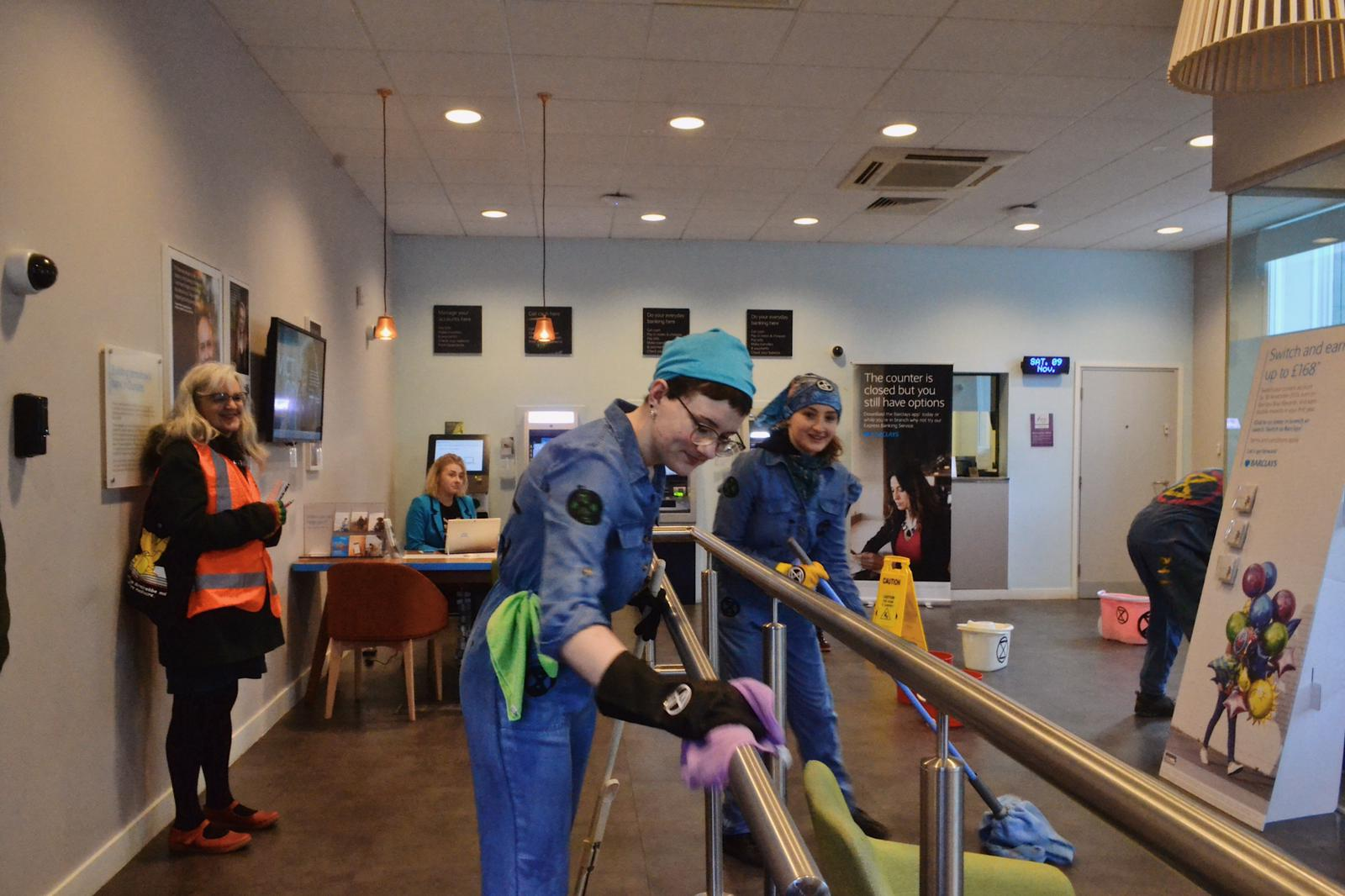 """Extinction Rebellion protesters """"cleaning up"""" the Barclays branch in Dundee."""