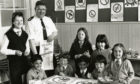 Pupils of Dens Road Primary, Dundee with Inspector Alistair Joss of Tayside Police with posters being designed by schoolchildren all over Scotland to promote road safety. Taken on May 24 1988.