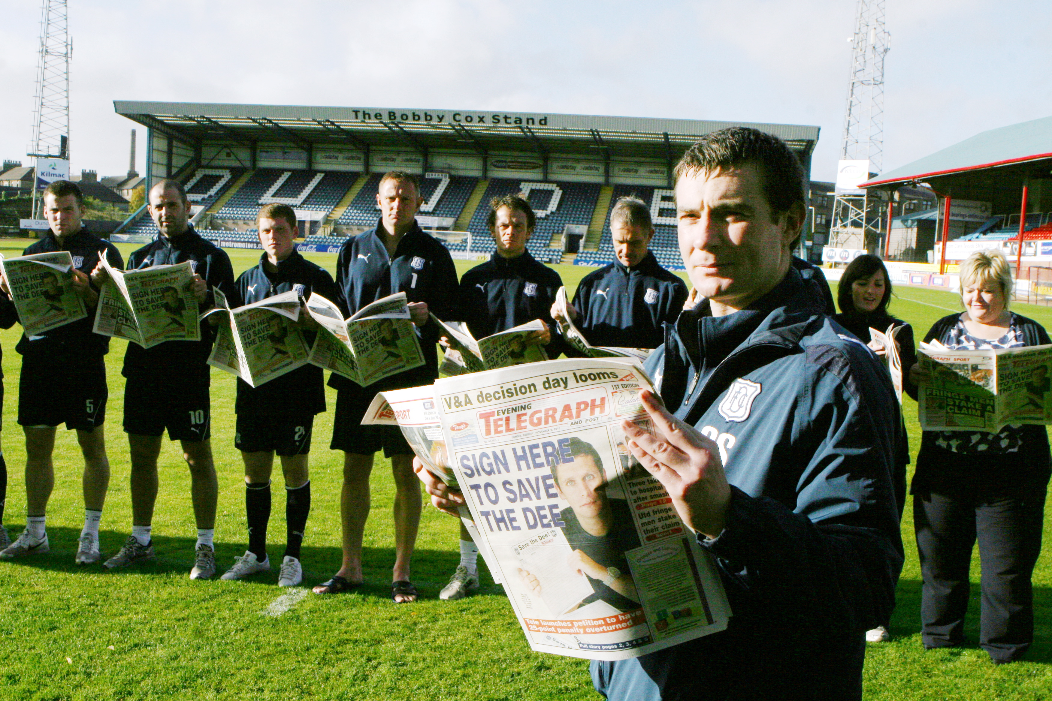 Barry Smith and the squad reading the latest news on the Dark Blues' plight in the Tele in 2010.