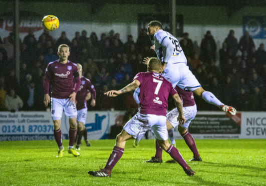 Dundee's Kane Hemmings scores to make it 1-1.