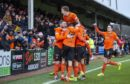 Dundee United's Sam Stanton celebrates his opener with teammates.