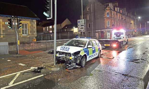 PC Mark Chance crashed into traffic lights in Perth following an overtaking manouver.