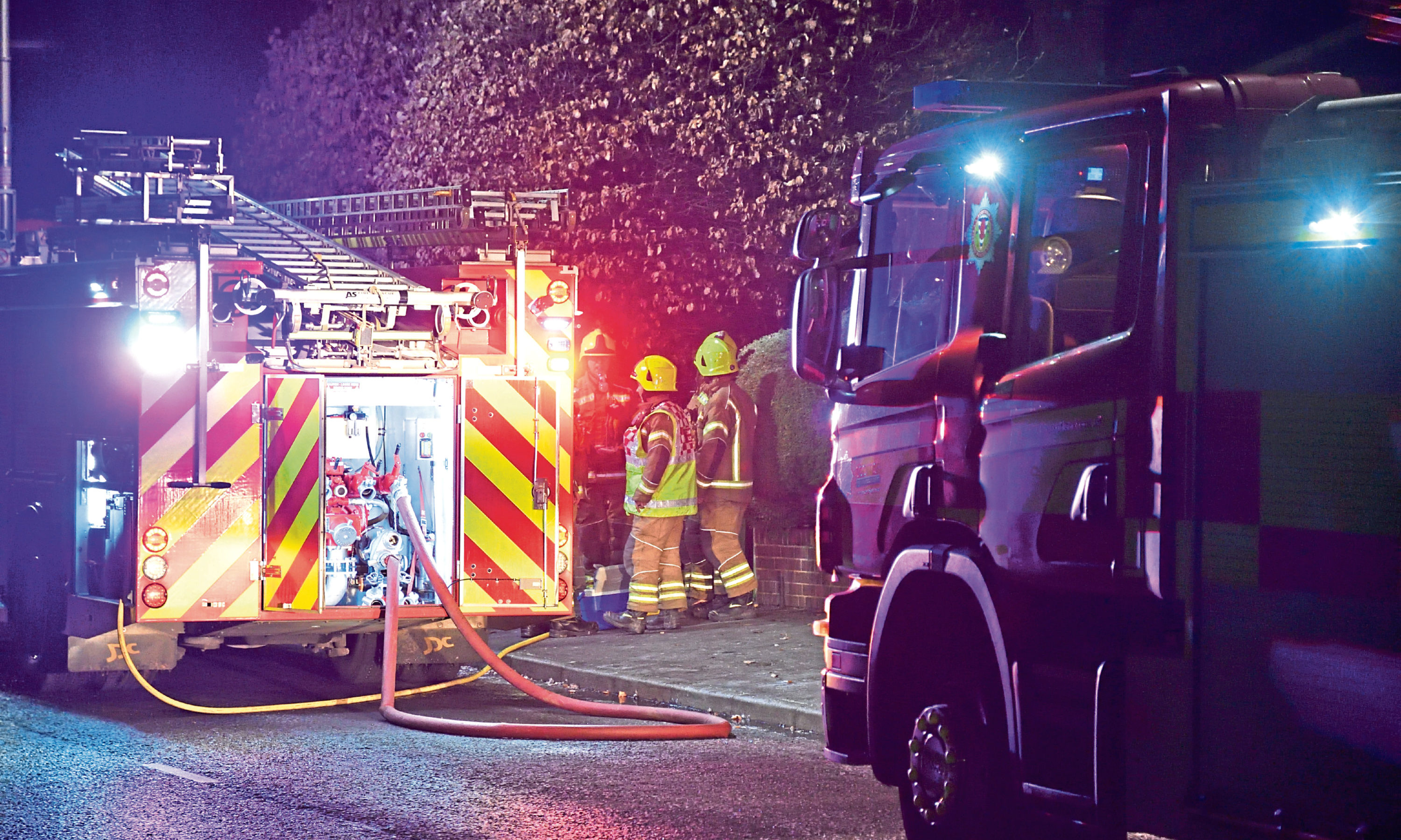 Firefighters attending the scene in Burghmuir Road on Saturday night.