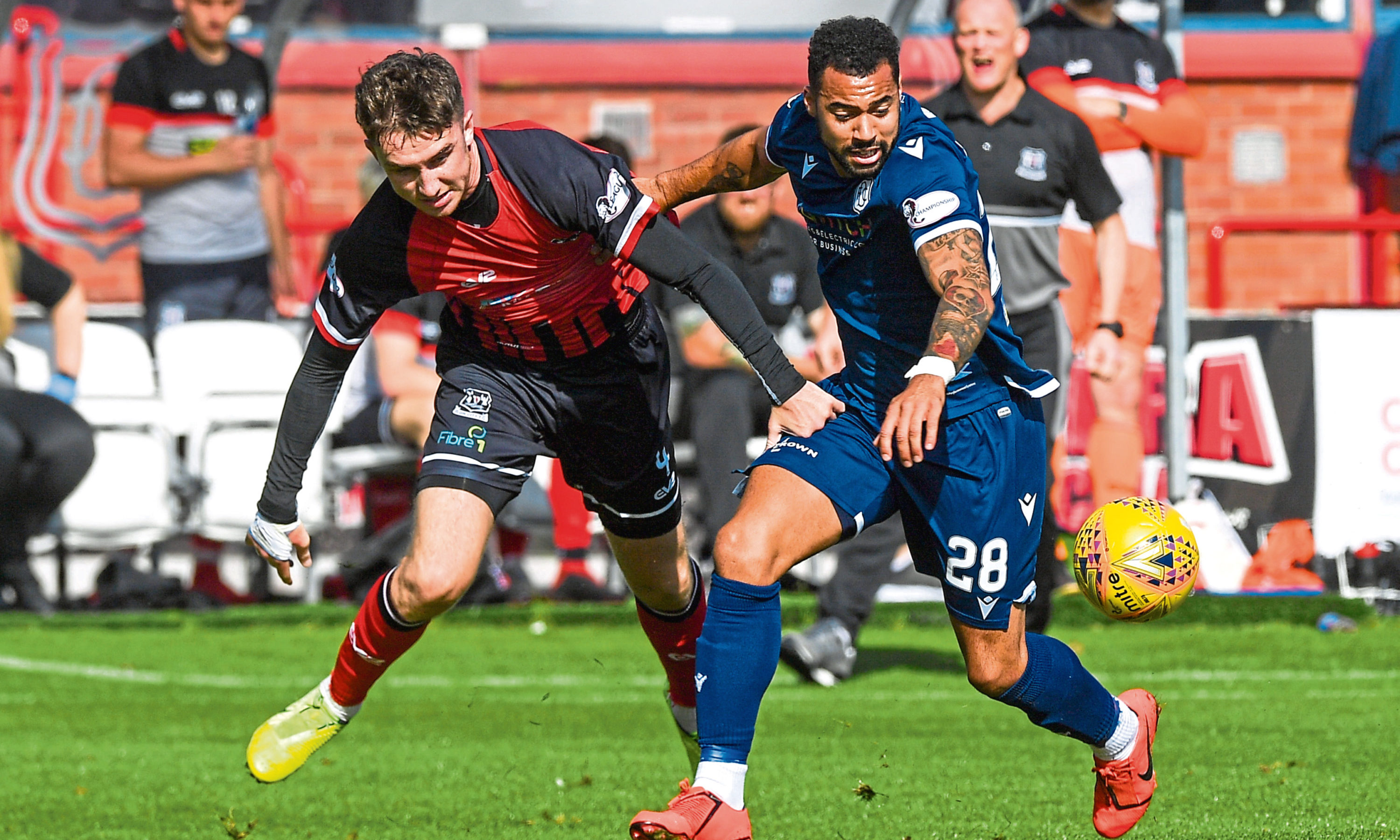 Kane Hemmings and Andrew McDonald of Elgin battle for the ball.