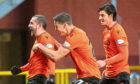 Paul McMullan, Louis Appere and Ian Harkes celebrate McMullan's goal against Queen of the South.
