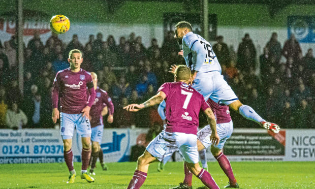 Dundee's Kane Hemmings scores to make it 1-1 during the match between Arbroath and Dundee.