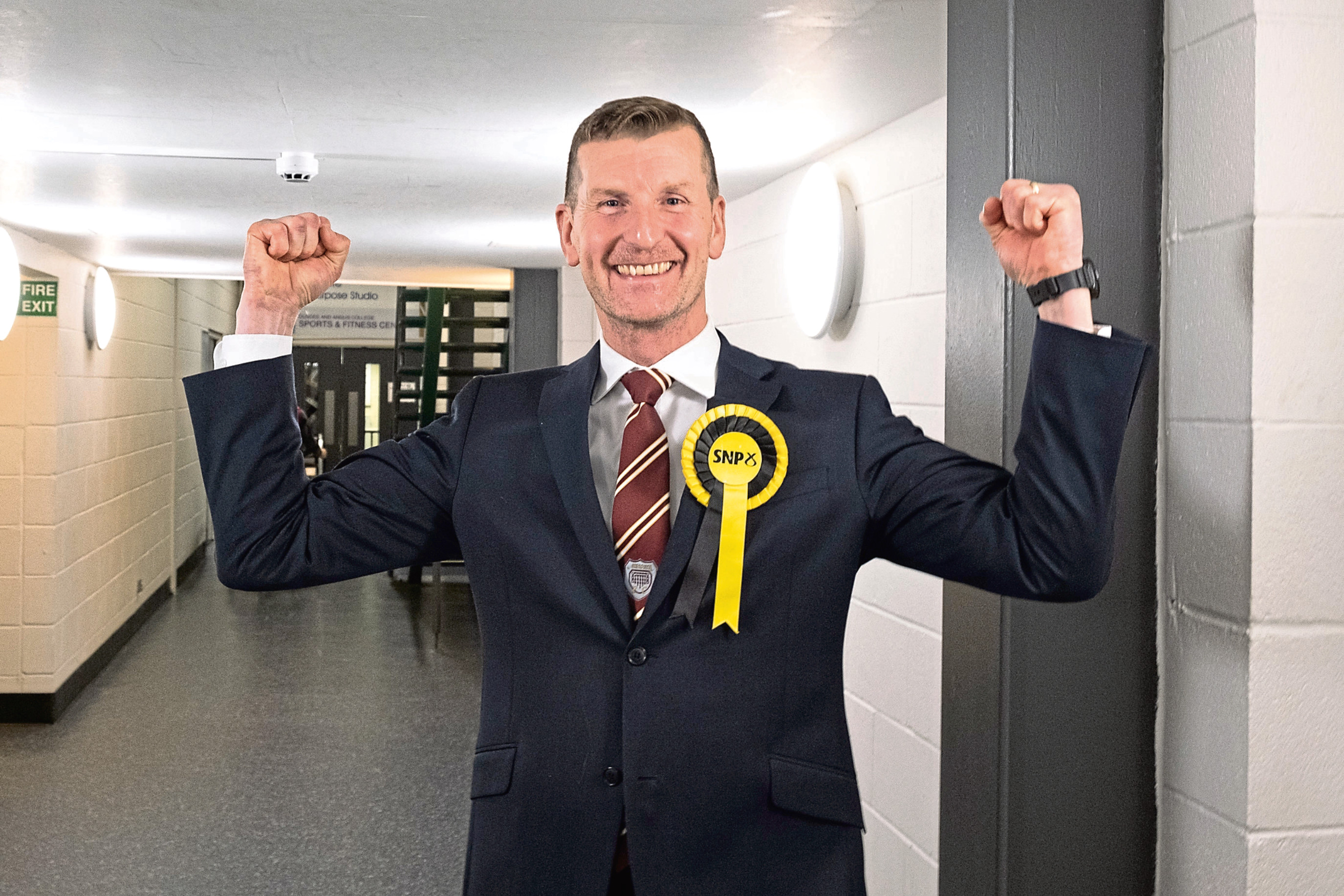 Doogan celebrating his victory at the Angus count.