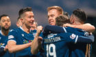 Dundee's Danny Johnson (centre) celebrates his goal with team mates after scoring to make it 4-1 against Dunfermline.