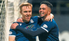 Johnson celebrates with Declan McDaid after scoring to make it 4-1 against Dunfermline.