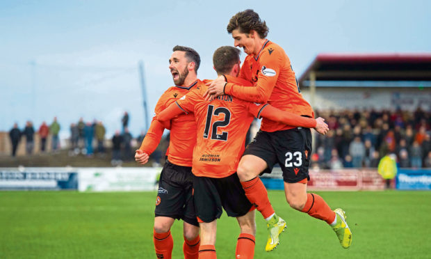 San Stanton celebrates his opener with Nicky Clark and Ian Harkes at Gayfield.