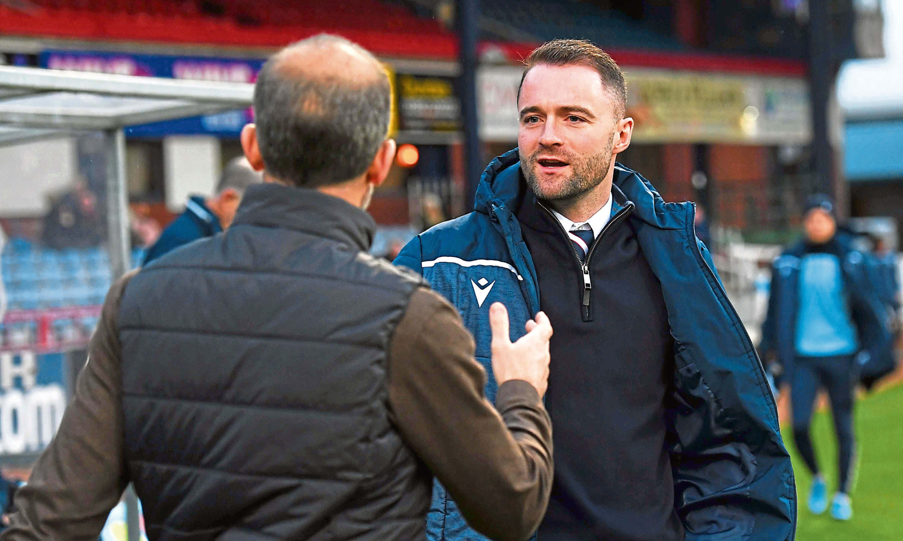 Dundee Manager James McPake shake hands with Dunfermline boss Stevie Crawford.
