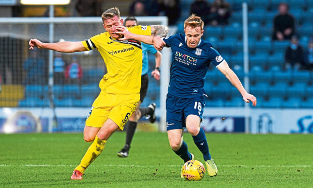 Danny Johnson, right, holds off Dunfermline's Lee Ashcroft.