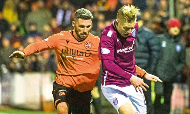 Nicky Clark (left) battles with Arbroath's Miko Virtanen.