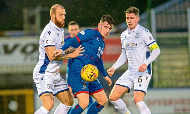 Aaron Doran holds off Dundee pair Jordan Forster and Josh Meekings.