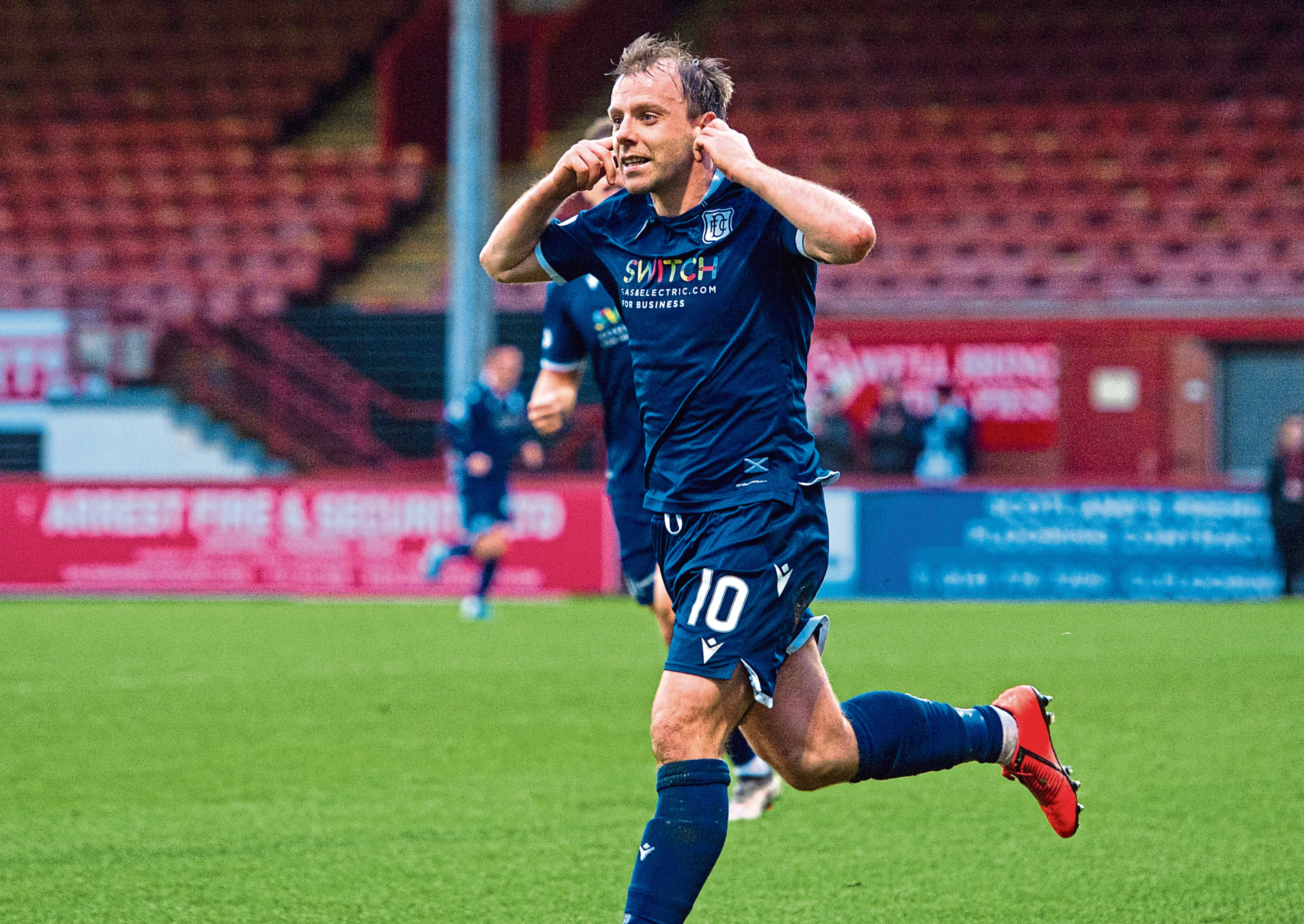 GLASGOW, SCOTLAND - DECEMBER 21: Dundee's Paul McGowan celebrates his goal after scoring to make it 1-0 during a Ladbrokes Championship match between Partick Thistle and Dundee, at Firhill Stadium, on December 21, 2019, in Glasgow, Scotland. (Photo by Sammy Turner / SNS Group)