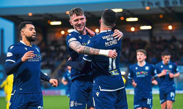 Dundee's Declan McDaid with Jordan McGhee.