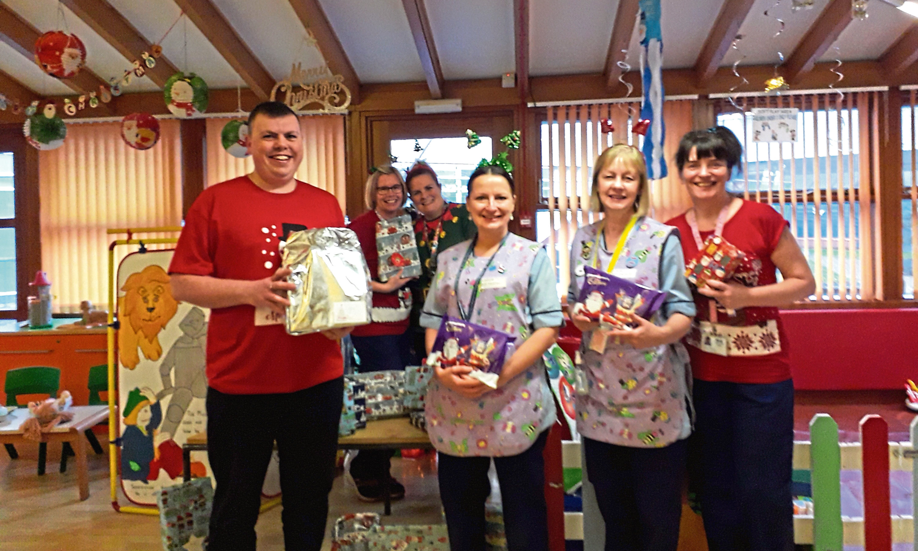 Some of the hotel staff with the gifts and selection boxes.
