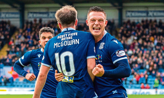Jordan Marshall celebrates with Paul McGowan, left, during a tie with Partick Thistle.